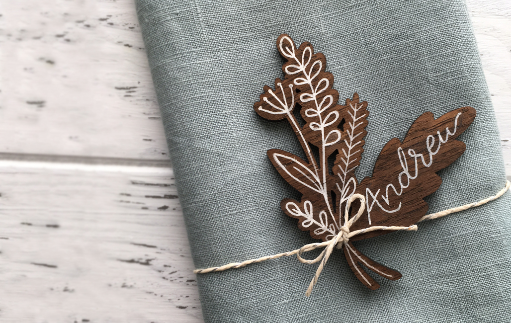 Maine wedding day details custom hand lettered place cards with a nature inspired feel