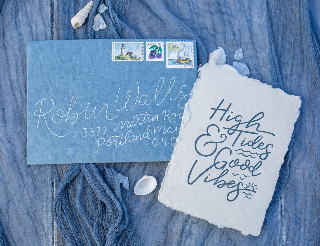 handmade envelope with handmade paper, deckle edge letterpress invitation suite. calligraphy envelopes with vintage postage stamps, inspired by the ocean for beach weddings