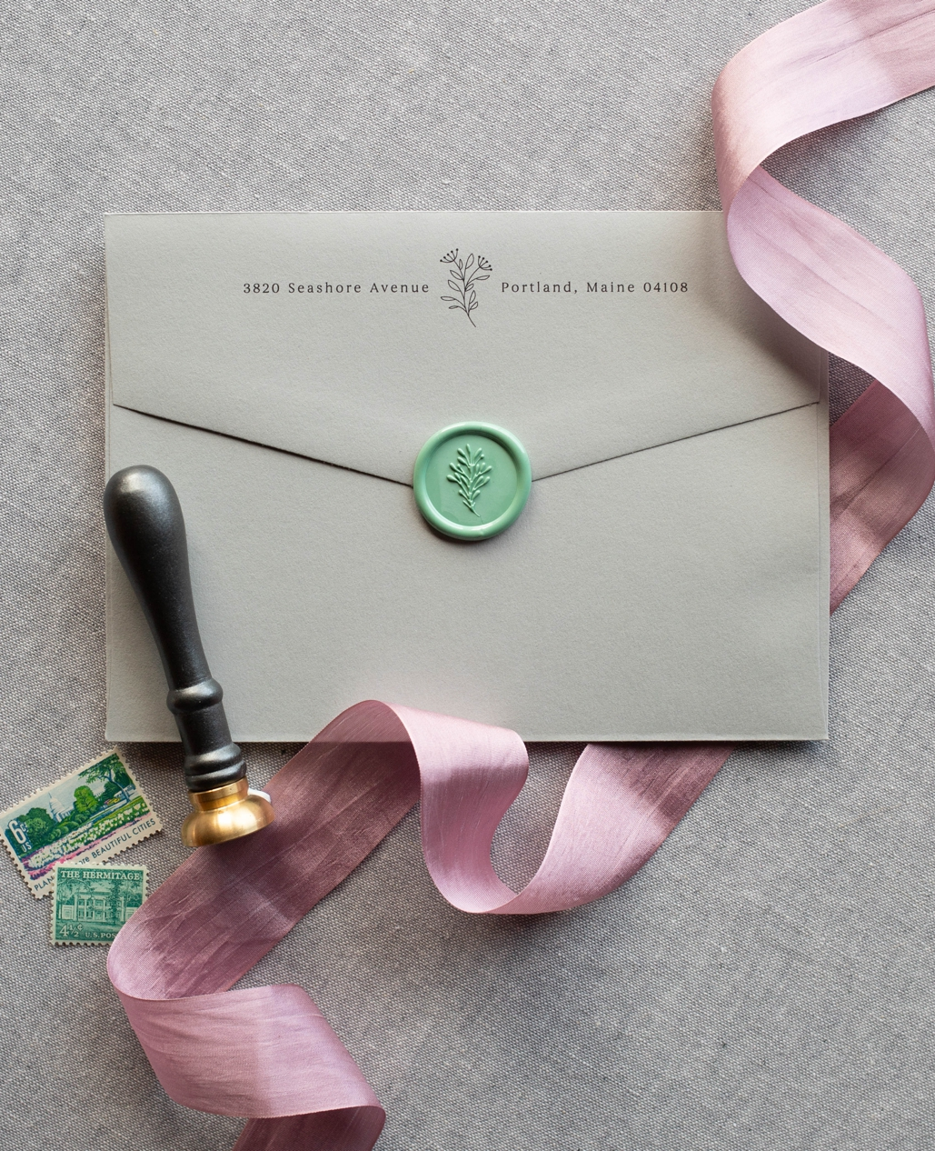 illustrated return address printed on wedding invitation with wax seal and silk ribbon, floral illustration modern