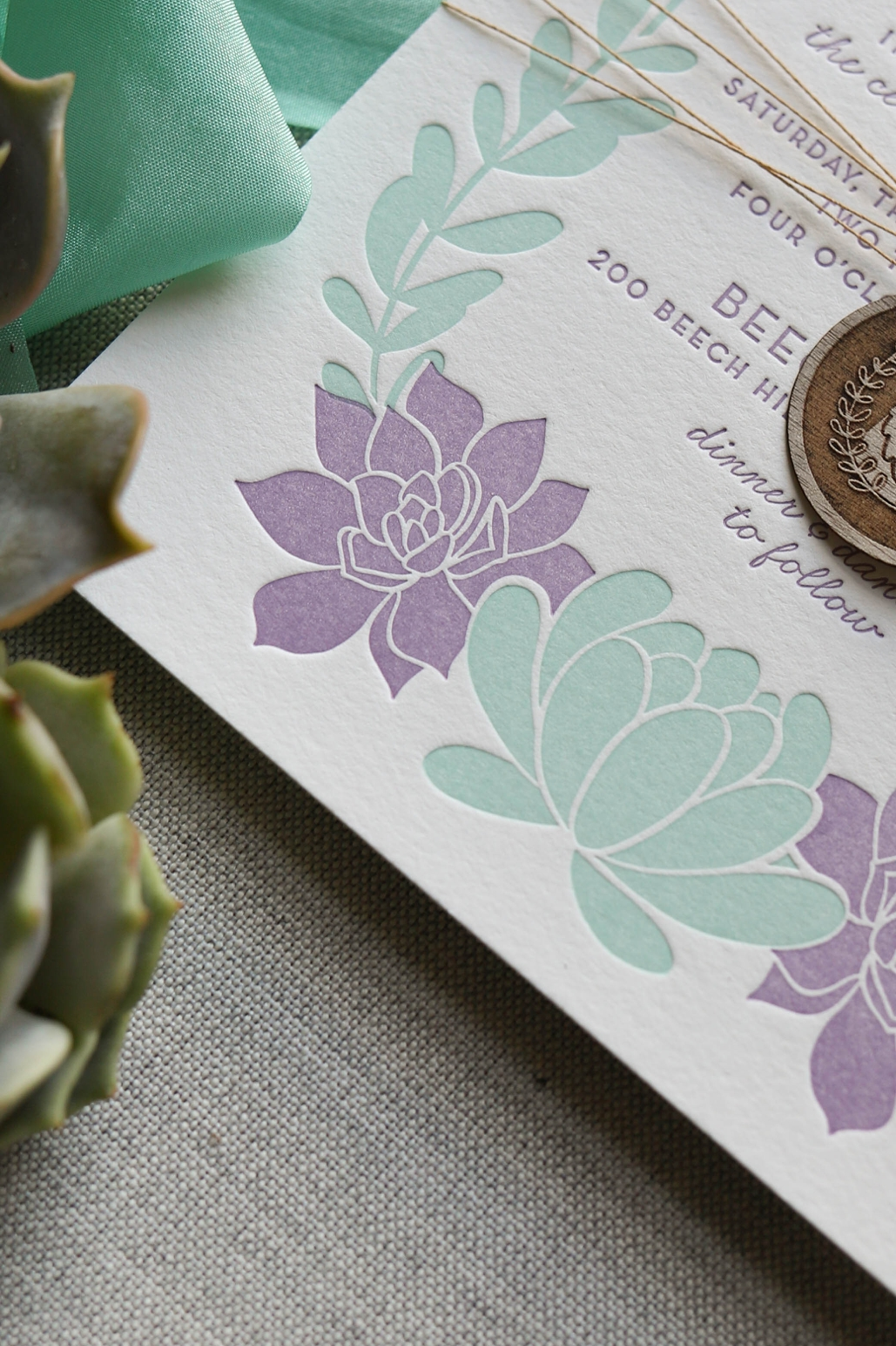 purple and green succulents illustrated for wedding invitations, custom wedding invitation designer with letterpress printing
