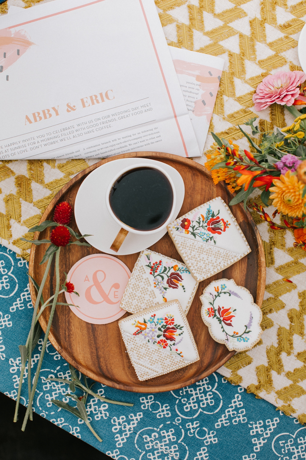 Sunday wedding brunch ideas, custom newspaper and decorated cookies, boho bride inspiration